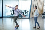 Graphic designer standing on hoverboard