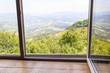 Old window with mountain views. - 118236117