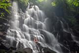 Fototapety serenity and yoga practicing at waterfall Kanto Lampo, Bali,Indonesia