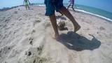 Carioca Brazilians beach football game playing kicking soccer ball