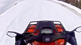 Riding on snowmobile pov