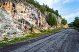 Asphalt road along the rocky mountains