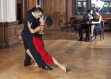 Tango Dancers Performing While Mid Adult Couple Dating