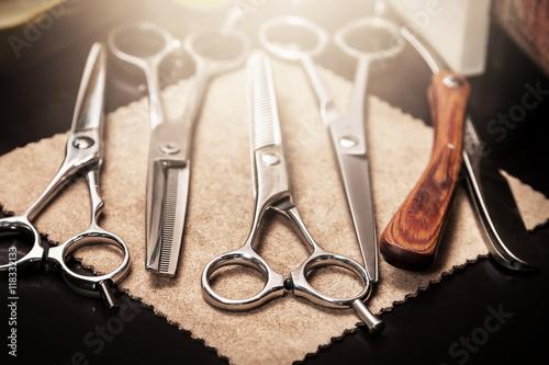 Straight razor and different scissors Poster