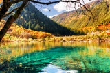 Azure water of lake among fall woods in the Shuzheng Valley
