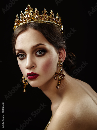 Plagát Beautiful brunette girl with a golden crown, earrings and profes