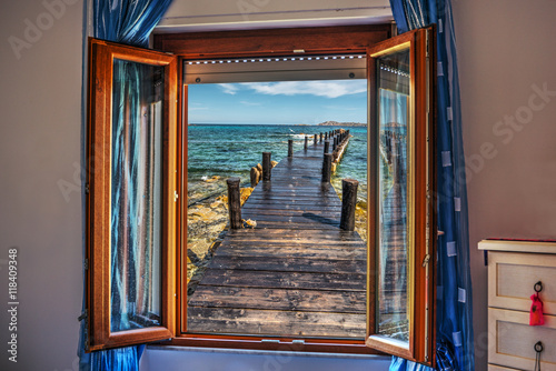 Fototapeta pier seen through an open window
