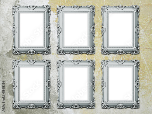 Close-up of six blank Baroque picture frames on gray and yellow old ...