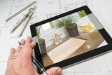 Hand of Architect on Computer Tablet Showing Luxury Bathroom Details Over House Plans, Compass and Ruler.