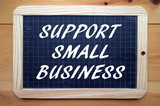 The phrase Support Small Business in white text on a blackboard as a reminder