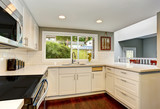White kitchen room interior With hardwood floor.