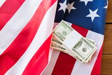 close up of american flag and dollar cash money