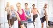 Leinwanddruck Bild - Smiling people doing power fitness exercise at yoga class