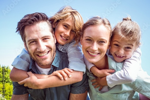 Happy parents with their children Poster