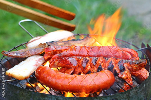 Sausages and bacon on the grill © Peter Jurik