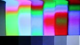 Color Bars Signal Damage. Color bars through a distorted signal. Videotape or film damage.