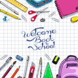 School background with school supplies on a paper