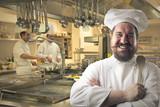 Happy chef smiling in a restaurant kitchen