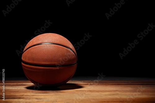 Fotobehang Basketbal Basketball on a hardwood court floor
