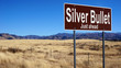 Silver Bullet brown road sign