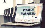 Refresh Marketing on Laptop in Meeting Room.