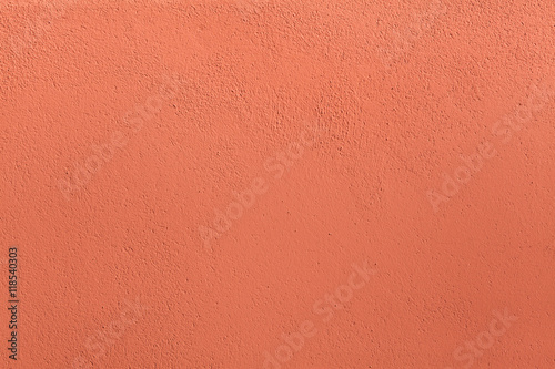 Terracotta painted stucco wall. Background texture
