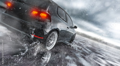 Fast Car driving fast on wet Road, water is splashing around