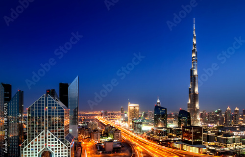 Poster Amazing sunset dubai downtown skyline with tallest skyscrapers and beautiful blu