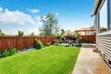 Beautiful landscape design for backyard garden and patio area - 118550598