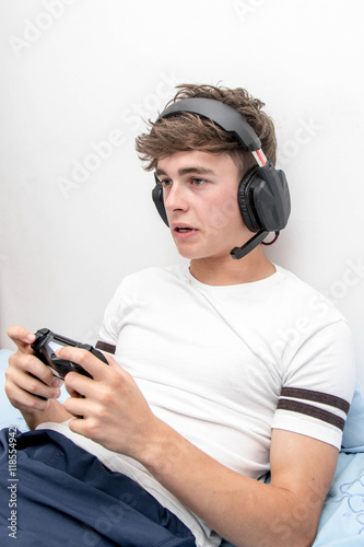 Poster Teenage boy playing a video game