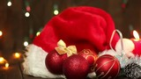 Hat of Santa Claus and Christmas tree decorations