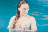 Portrait of mysterious seductive woman in water.