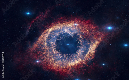The Helix Nebula is a large planetary nebula located in the constellation Aquarius. Elements of this image furnished by NASA.