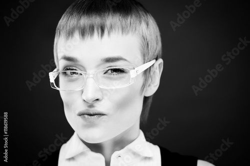 Portrait of beautiful young woman with straight hair posing © Ruslan Moore