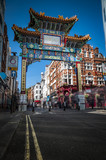 The Gate in chinatown, london, England with glazed yellow tiles, a golden dragon, painted panels, two white jade plaques and gold foil. The Chinese text translates 'Peace and Prosperity to Chinatown' - 118677122