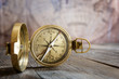 Old compass on the vintage map background. Retro style.