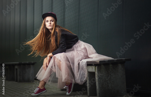 Trendy beautiful long haired girl posing, hip hop fashion Poster
