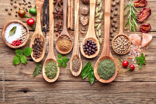 Fototapety, obrazy : Spices with fresh herbs on a wooden background
