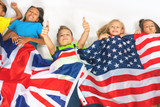 Fototapety Funny kids holding flag Great Britain and american national flag
