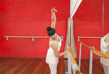 Dancer Holding Barre While Practicing In Ballet Studio