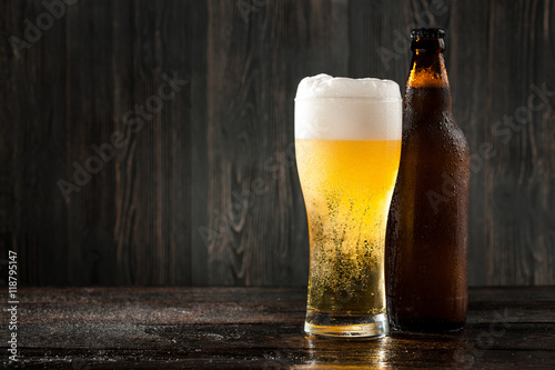Fototapeta Glass of beer and beer bottle