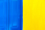 Blue door and yellow wall texture