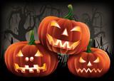 Three pumpkins in a creepy Halloween scene.