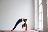 Yoga woman at home.