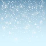 Falling flakes of snow on light blue background