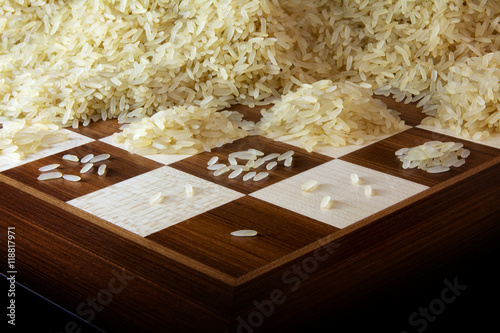 chessboard with growing heaps of rice grains, legend about the exponential growt Poster