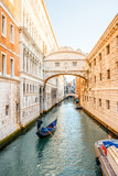 Water canal with famous bridge of Sights with gondola near Doges palace in Venice