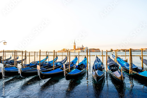 Venice landscape view on San Giorgio Maggiore island with gondolas on the foregr Poster