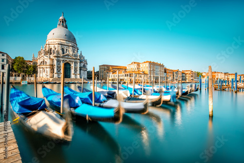 Venice cityscape view on Santa Maria della Salute basilica with gondolas on the Grand canal in Venice Poster