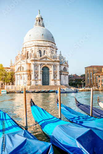 Venice cityscape view on Santa Maria della Salute basilica with gondolas on the Poster